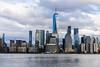 City Blue (brianloganphoto) Tags: building manhattan northamerica water reflections newyork hudsonriver clouds blue urban river newyorkcity landscape sky landmark unitedstates regions skyline city jerseycity newjersey us