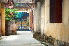 Young boy playing in an alleyway (BryonLippincott) Tags: asia asian southeastasia vn vietnam vietnamese vietnameseculture countryside farm farming hanoi agriculture rural ruralscene farmscene farmland country industry production community outdoors sunlight trees alleyway windowsshutters red boy young playing play alone one