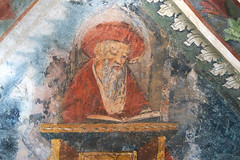 The Old Man and His Book (YIP2) Tags: murals frescoes jerome santuariodellamadonnadelcarmine sanctuary ladyofmountcarmel prunetto piedmont piemonte italia cuneo italy rain weather hills landscape building travel street wet church pieve romanesque architecture painting wall