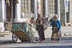 Tibetan women with prayer wheels (bag_lady) Tags: approved tibet buddhism gyantse oldtown tibetanwomenwithprayerwheels street urban prayerwheels buddhist
