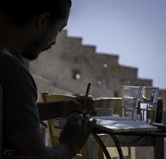Recording history (Kostis Tatakis) Tags: candid people man writting reading book castle monemvasia fortress castello cafe mani peloponnese greece nikond7200 portrait