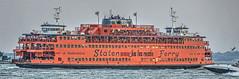 evening ferry home (albyn.davis) Tags: nyc newyorkcity manhattan boat ferry color orange people water sea harbor transportation