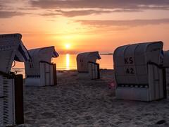Early morning on the beach (katrin glaesmann) Tags: timmendorferstrand ostsee schleswigholstein balticsea bayoflübeck lübeckerbucht sunrise sleswickholsatia derechtenorden therealnorth beach beachchair strandkorb sand clouds