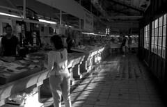 The Fish Market (Gabo Barreto) Tags: mahon mao menorca balearicislands stalls fishmonger light windows customers fish market 35mm film rangefindercamera vivitar35es ilfordhp5 xtol selfdeveloped scannedfromfilm epsonv500 blackandwhite monochrome filmisnotdead ishootfilm
