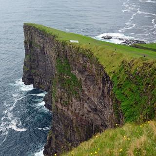 Big cliff, small men
