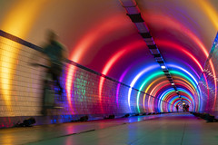 biking through the rainbow (Blende1.8) Tags: antwerp antwerpen tunnel tunnelblick cyclist biker fahrradfahrer sanktannatunnel fahrrad bike color colors colorful colourful vanishingpoint fluchtpunkt belgien belgium flandern vlaanderen city urbay colours movement moving bewegung sony alpha ilce6300 sel18135 18135mm vivid vividcolors emount a6300 carstenheyer underground untergrund art public architecture tunnelvision