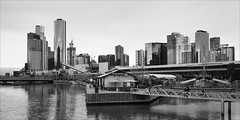 melbourne-1035-ps-w (pw-pix) Tags: city river buildings shed docks jetties sky clouds cloudy winter bw blackandwhite monochrome boatbuildersyard theboatbuildersyard fromseafarersbridge southwharf yarrariver pollywoodside ship boat sailingship docklands melbourne victoria australia peterwilliams pwpix wwwpwpixstudio pwpixstudio