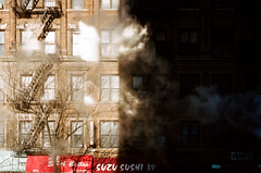 urban shadow 1: sushi, firescape, and the Manhattan steam (NYC Macroscopist) Tags: fireescape shadow shadowplay light sunlight steam sushi newyork manhattan architecture symmetry geometry perspective facade orange red urban geometric modern city street abstract stronglight darkness film analog vintage leica summicron 50mm 35mm manhattansteam newyorksteam