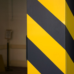 Striscie gialle e nere in 3D. Yellow and black stripes in 3D ( Abstract reality) (sandroraffini) Tags: abstract realiry black yellow nero giallo sony rx100m1 urban details minimalismo minimalism dof stripes striscie 3d colonna column parallelepipedo sandroraffini bologna exploration frammenti fragments semplici forme simple shapes colore color optical
