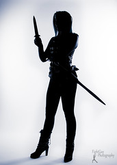Sucker Punched - Vega (FightGuy Photography) Tags: sword weapon blade suckerpunched cosplay studiophotography fightguyphotography boots longhair warriorwoman silhouette knife dagger