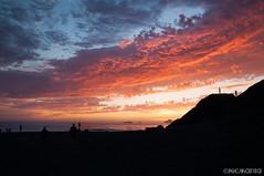 Set the World on Fire (Nick Kanta) Tags: clouds color d90 humbugmountain nikon ocean oregon oregoncoast outdoorphotography people rocks sand seastacks silhouette sky sunset tamron1750 water