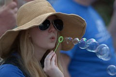Blowing Bubbles (Scott 97006) Tags: woman female lady bubbles blow hat cute shades