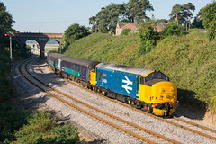 37409 Reedham 23/07/18 - With 37409 back on the Norwich end of the short set, 2J67 was aim this morning. With Reedham Swing Bridge and Maypole Hill bridge in the background, the tractors creep around the curve on the approach to Reedham station. (rhayward92) Tags: class 37 drs direct rail services 37409 reedham 2j67 br large logo