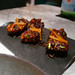 Imagine American pickled relish but instead of American stuff it's Indian stuff. Things like chili, turmeric, fermented produce. That's achaar. A bold, tangy, sweet condiment to glaze these ribs. Meetha Achaar Ribs, Sun Dried Mango, Onion Seeds $12