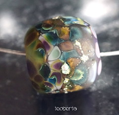 Teoberta (Laura Blanck Openstudio) Tags: openstudio openstudiobeads glass murano handmade beads single focal bead jewelry necklace pendant whimsical funky odd abstract asymmetric fine arts art artisan artist colorful multicolor earthy organic nuggets speckles frit boho soho urban chic upscale boutique big holes huge round donut etched matte frosted opaque eggplant plum sterling silver silvered periwinkle blue fuchsia mauve magenta purple violet lavender lilac brown honey suede caramel ocher orquid transparent glow glowing green teal kiwi parrot lime chartreuse mosaique