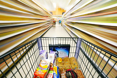 Cruisin' Down the Snack Aisle (Kirby Wright) Tags: grocery store shop shopping cart aisle goldfish cookies crackers bread snacks blur long exposure basket super wide angle fast moving motion streaks speed light customer deli meat nikon d700 rokinon 14mm 14 f28 28 balance balancing act action creative food
