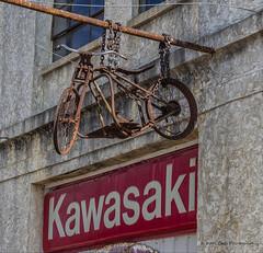 Kawasaki (Kool Cats Photography over 10 Million Views) Tags: bike motorcycle kawasaki rusted old antique shop store sign oklahoma chains hanging