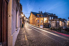 """lights pass the yellow corner house as night falls, Honfleur, Calvados, Normandy, France (grumpybaldprof) Tags: canon 70d """"canon70d"""" sigma 1020 1020mm f456 """"sigma1020mmf456dchsm"""" """"wideangle"""" ultrawide """"fineart"""" ethereal striking artistic interpretation impressionist stylistic style contrast shadow bright dark black white illuminated colour colours colourful """"longexposure"""" night dusk crepuscular honfleur normandy normandie france calvados"""