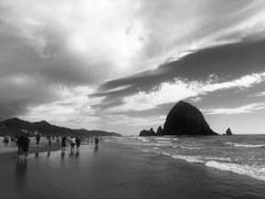 Cannon Beach, Oregon (thebettyfrondclinic) Tags: pacificocean coastline summer sky clouds eaves sand haystackrock noir blackandwhite blackwhite beach oregoncoast oregon cannonbeach