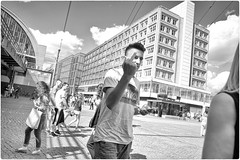Deutsch Middle Finger (Steve Lundqvist) Tags: germany germania berlin berlino alexanderplatz platz square boy nikon nikkor 24mm blackandwhite bw kid monochrome deutschland shorts sweatshirt hairstyle people gente street streetwear streetphotography teenager teen train station bridge berliners berliner architecture building windows chimney smokestack stack torre ciminiera tower middle finger gesture