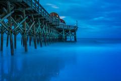 First light under the pier (Browtine1) Tags: ocean long exposure pier south carolina apache myrtle beach blue