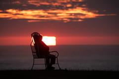 The Going Down of The Sun (ianrwmccracken) Tags: horizon memorial silhouette sunset coast cloud whitby yorkshire england telephoto nikon evening orange sea d750 scenic landscape