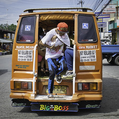 Hold the Baby (Beegee49) Tags: street woman mother baby carrying jeepney public transport bacolod city philippines