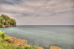 Into The Eternal Horizon (Pearce Levrais Photography) Tags: hdr canon landscape lake ontario outside summer summertime tree house harbor dock shore nd filter photoftheday pickoftheday hdrmerge hdrphoto hdrphotography tropical sky cloud time exposure outdoor nature plant rock stone calm water