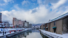 Beautiful view of old warehouse at Otaru canal in Sapporo, Hokkaido, Japan with snow cover on roof. Traveler traveling at Otaru canal is one of most famous place in Sapporo, Hokkaido, Japan in winter (MongkolChuewong) Tags: architecture asia autumn background blue boat building canal city cityscape cloud cold cover day destination fall hakodate historic hokkaido japan japanese landmark landscape light old otaru outdoor port reflection river sapporo scenery season sightseeing signature sky snow tour tourism tourist town traditional travel twilight vacation view warehouse water white winter