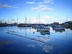 Reflections of Newlyn Harbour, Cornwall (Mark Curnow Photography) Tags: ocean harbour reflection cloud ripple vignette huawei snapseed outdoors outdoorphotography phone cornwall cornish kernow summer season coast village town warm evening traquil mood relax blue vivid