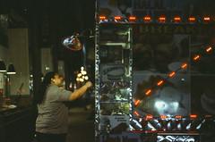 Ektachrome nightcrawlers 8: under the spotlight (NYC Macroscopist) Tags: nightcrawlers newyork nyc manhattan midtown latenight lowlight dark film vintage ektachrome analog leica summilux 50mm lowiso grainy grain street atmospheric moody streetfood foodtruck subdued mood bokeh