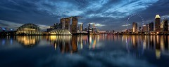 Singapore blues (reinaroundtheglobe) Tags: singapore marinabay gardensatthebay water skyline waterreflections longexposure bluehour ferriswheel panorama nopeople waterfront clouds asia illuminated blue city buildings skyscrapers cityscape
