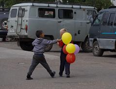 Assault (Alexander-_-Laz) Tags: russia buryatia babushkin people children balloon colourful attack celebration car grey yellow red