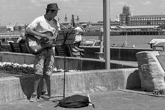 Busker (FryFotos) Tags: sea harbour sky guitar hat music bw mono n5300