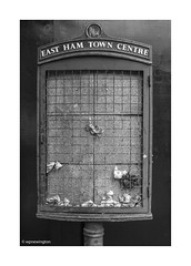 East Ham Town Centre © (wpnewington) Tags: society abandoned rubbish towncentre monochrome eastend eastham london signs street decay grime change