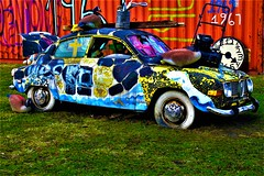 I only left my car for a minute! (SCOTTS WORLD) Tags: adventure america angle art artwork city color crusty car detroit digital detail 313 exploring exhibit michigan motown midwest motorcity morning mural fun march 2018 heidelbergproject hff panasonic pov perspective outdoors outside fence spring texture tires lawnmower garbagecan ducks wateringcan