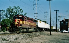 WC 6560 in Des Plaines, Illinois on June 15, 1993. (soo6000) Tags: emd 6560 sd45 wc wc6560 desplaines illinois deval interlockingtower railroadtower x41 intermodal jbhunt wisconsincentral