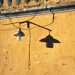 Lamp and Dark Lamp (petemenzies.com) Tags: shadow light lamp asymmetry sunlight shadowplay lines shapes wires electricity lightbulb hoian travel vietnam asia wall study cord switch uncool cool uncool2 uncool3 uncool4 cool2 uncool5 uncool7 c2u7