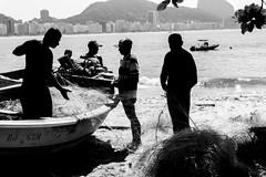 Fishermen (Luiz Contreira) Tags: riodejaneiro rio brazil brasil blackwhite brazilianphotographer beach pretoebranco praia southamerica boat barco people pb pessoas monocromático sun américadosul