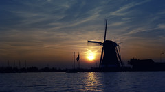 Sunset Mill (rvroel) Tags: netherlands zuidholland sunset landscape water mill windmill