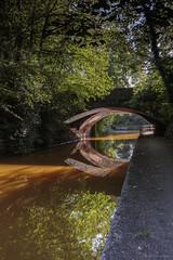 The orange canal (andyrousephotography) Tags: worsley bridgewatercanal canal worsleybridge waterways orange ironore mining mines sunlight shine colours colourful