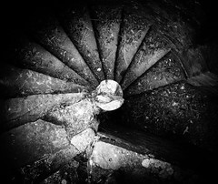 Down into darkness (Stuart.67) Tags: blackwhite mono spiral staircase stone castle usk nikon d800 round ancient historic south wales uk