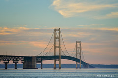 Mackinac Bridge (mswan777) Tags: michigan mackinaw 70300mm sigma d5100 nikon coast shore water glow blue orange cloud sky evening scenic nature outdoor straits bridge mackinac tower cable suspension