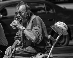 A drinking man's essential needs (Frank Fullard) Tags: frankfullard fullard candid street portrait hatstand hat stand crutch drink alcohol monochrome blackandwhite black white blanc noir galway irish ireland can thirst slake quench dovemenscare