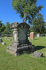Norris Grave, St. Mary's Cemetery — Marion, Ohio (Pythaglio) Tags: marion ohio marioncounty stmarys saintmarys cemetery catholic graveyard gravestone tombstone marker stone headstone fauxwood rustic whimsical norris