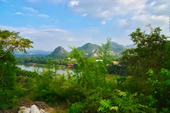 View over the river Kwae Noi near Wat Tham Khao Pun in Kanchanaburi, Thailand (UweBKK (α 77 on )) Tags: view scenery scene scenic landscape river kwae noi kwaenoi kwai trees forest mountains sky watthamkhaopun wat tham khao pun kanchanaburi thailand southeast asia sony alpha 77 slt dslr