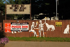Drunk Skeleton's - Coloma, Wisconsin (Cragin Spring) Tags: wisconsin wi midwest unitedstates usa unitedstatesofamerica coloma colomawi colomawisconsin smalltown pokerrun skeleton beer cabinbargrill fence sign coyote fishfry breakfast lunch deer turkey