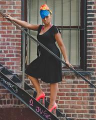 Alluring & Gritty (adrianmichaelphotography) Tags: fashion fashionmodel model blue bluehair blackdress stairs highheels gritty grimy rainbow rainbowhair window beauty beautymodel woman africanamerican africanamericanwoman nikonflickraward ebony blackisbeautiful