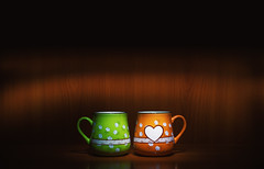 Two Lovely Cups (dejankrsmanovic) Tags: cup coffee two pair green orange box container cutlery private relationship symbolic concept conceptual illuminated object stilllife model retro vintage decor decoration flower shape heart love valentinesday valentine wood wooden brown inside indoor furniture home