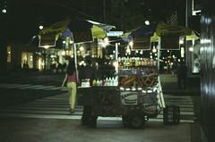 Ektachrome nightcrawlers 7: the vendor is absent (NYC Macroscopist) Tags: foodcart streetfood hotdog night street manhattan midtown newyork ektachrome slidefilm vintage analog film leica summilux 50mm retrochrome160 atmospheric mood grainy colors 5thavenue negativespace grain